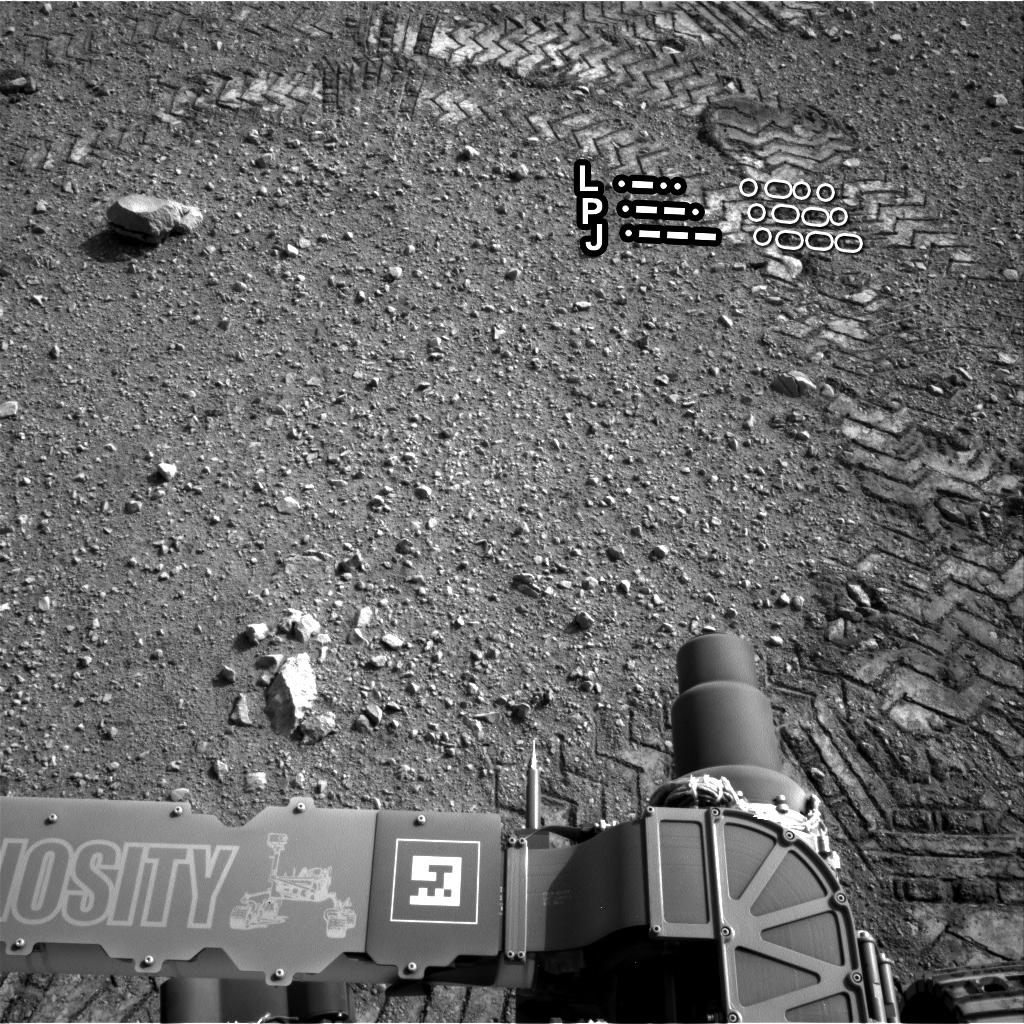 Curiosity - ślady kół z tekstem zapisanym morsem (opis)